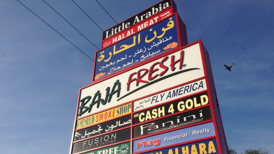 A shopping center in West Anaheim bears the Arabic names of Arab-owned shops and restaurants.