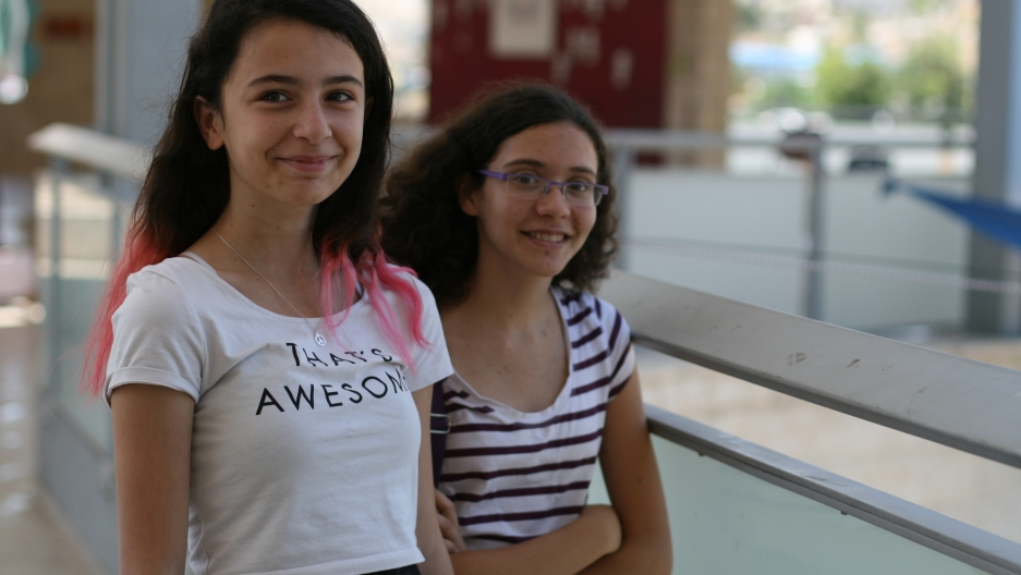 """Lelia Ben-Horin, left, and Inbar Shaked-Vardi, both 14, say at this Jewish-Arab summer camp, """"there are no teams"""" cheering on Israel or Hamas. """"This war is between people who are full of hate."""""""