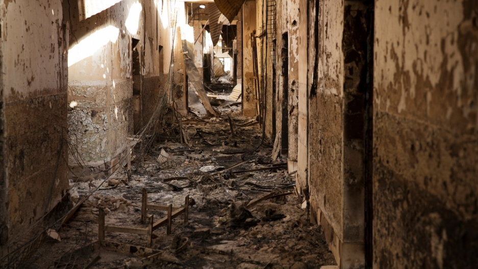 Debris litters the floor as sunlight shines through the damaged roof of a scorched corridor, 14 October 2015, in MSF's Kunduz Trauma Center in Kunduz, northern Afghanistan.