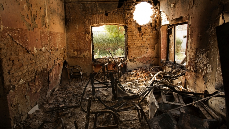 Interior view of the MSF Trauma Center, 14 October 2015, shows a missile hole in the wall, and the burnt-out remains of the building after a sustained attack on the facility in Kunduz, northern Afghanistan