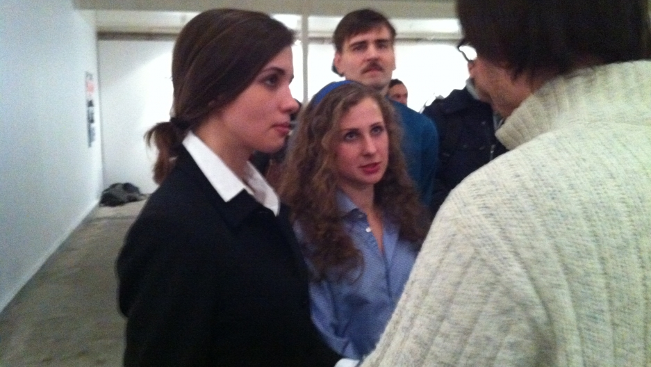 Pussy Riot's Nadia Tolokonnikova and Maria Aliokhina speak with friends at the opening of protest art in support of their rights while in prison.