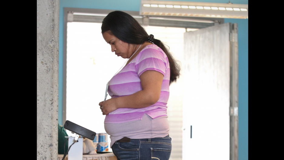 A patient weighs herself during a Centering Pregnancy session at San Francisco's Homeless Prenatal Program, which collaborates with San Francisco General Hospital and offers space for the meetings.