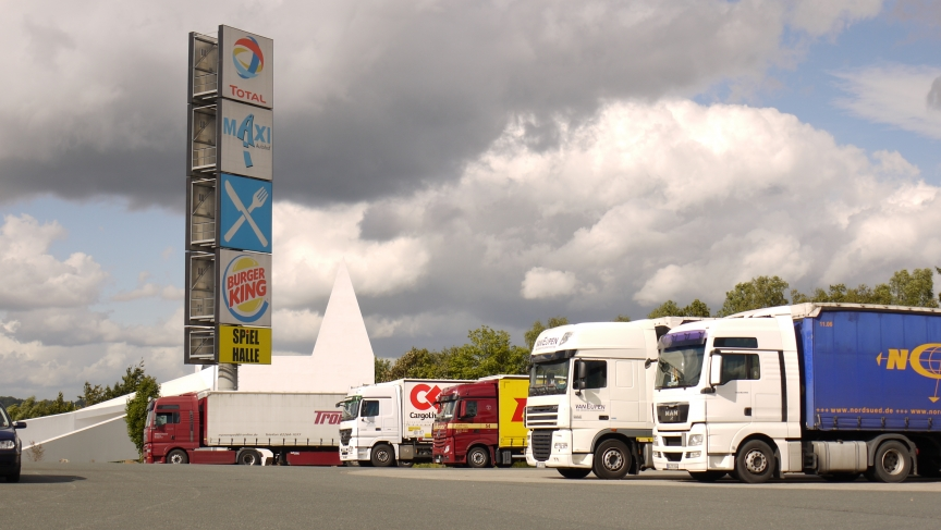 Trucks parked in front of the Siegerland's highway church.