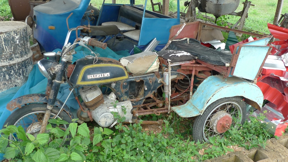 """Dr. Awojobi calls this small, open-air shed his """"museum."""" It houses the prototypes of inventions that he has developed over the years. The tricycle ambulance, converted from an ordinary motorcycle, was designed by his brother."""