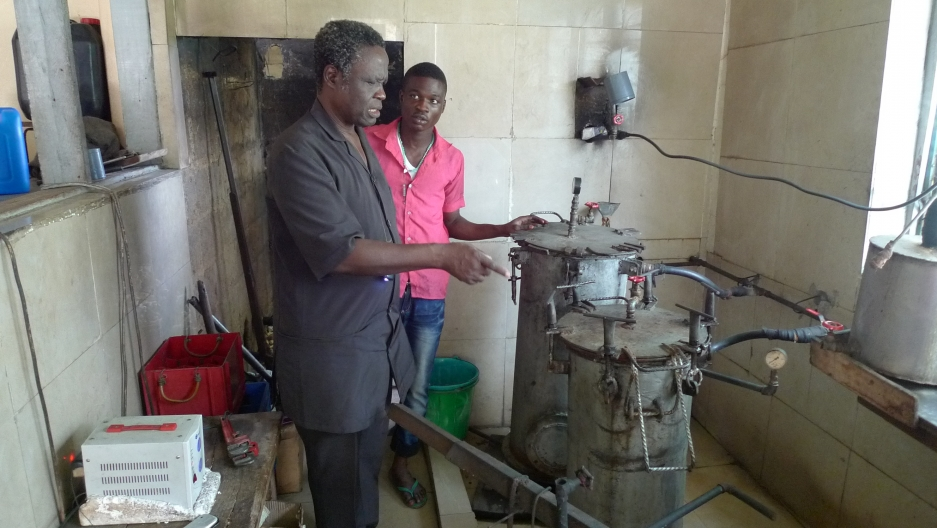 Dr. Oluyombo Awojobi inspects the autoclaves at his clinic in Eruwa, Nigeria. The autoclaves, which sterilize surgical equipment, are made from recycled propane cylinders.