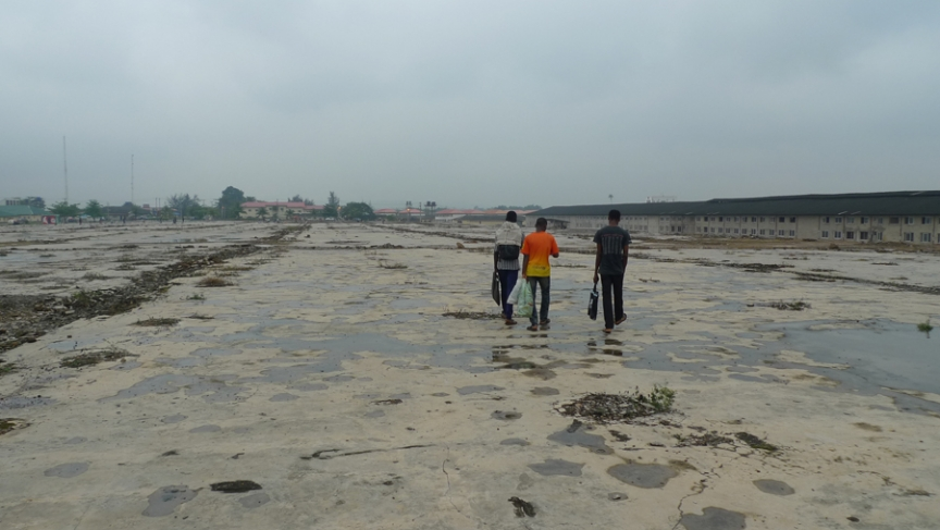 Worshippers arriving early to the Holy Ghost Service walk across the foundation of a prayer hall demolished a few years back.