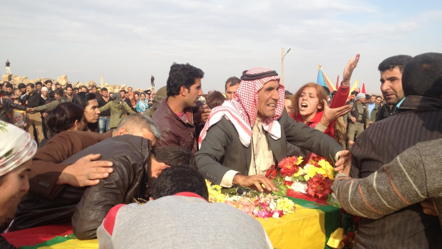 A few hundred Kurdish fighters and civilian buried the latest casualty in the war against radical Islamist groups.