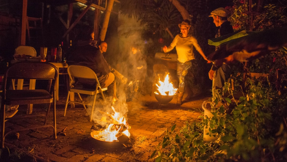 Persian New Year celebrations include jumping over a fire, dancing and eating, 'ash,' a Persian stew made with beans, spinach, cilantro, parsley, broth and rice or noodles.