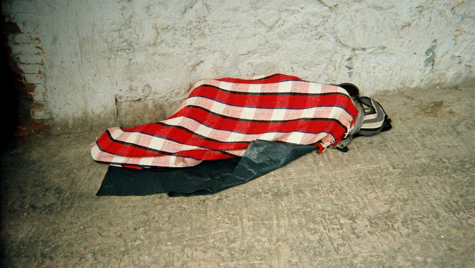 """""""This photo was taken by a member of a local community who works to aid migrants in Mexico,"""" says Pindado. """"Here's this migrant, sleeping outdoors, exhausted."""""""