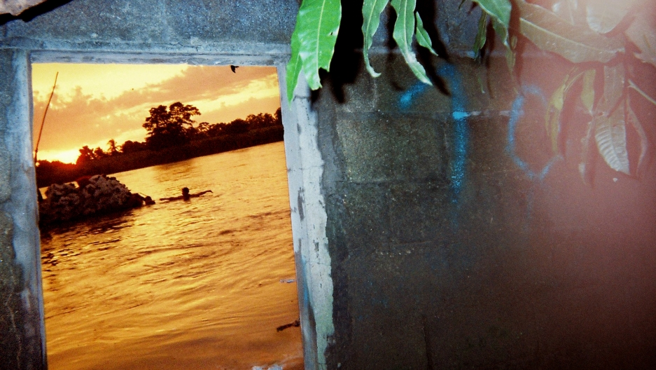 """""""A lanchero took this photo,"""" says Pindado. """"A lanchero is someone who runs the small boats carrying everything from food to people, and the guy who took this works along the river that runs along the Guatemala-Mexico border. A lot of lancheros can be sti"""