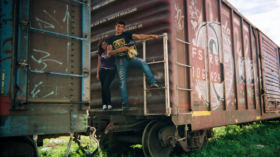 """""""This photo was taken by a volunteer at a church-run migrants shelter,"""" says Pindado. """"We don't know much about the two people in this photo, whether they are a couple or not. It's true, though, that if you're a migrant women traveling alone through Mexic"""