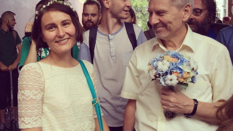 Anna Karpova and her father, Feodor, on the day of her wedding, in prison, to Alexei Gaskarov. Gaskarov has been sentenced to three years in prison for his part in an anti-Putin protest in May 2012.