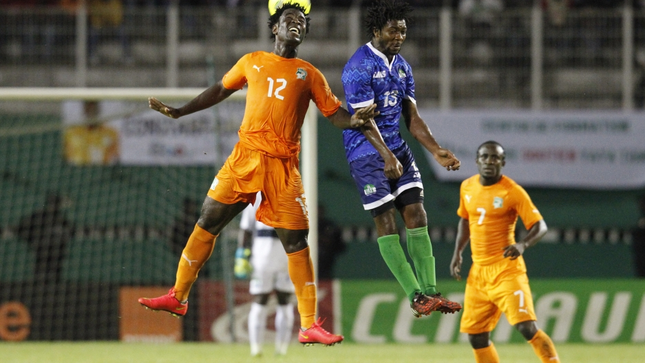 Sierra Leone's Michael Lahoud fights for the ball with with Ivory Coast's Wilfried Bony during their 2015 African Nations Cup qualifying soccer match at the Felix Houphouet Boigny stadium in Abidjan on September 6, 2014.