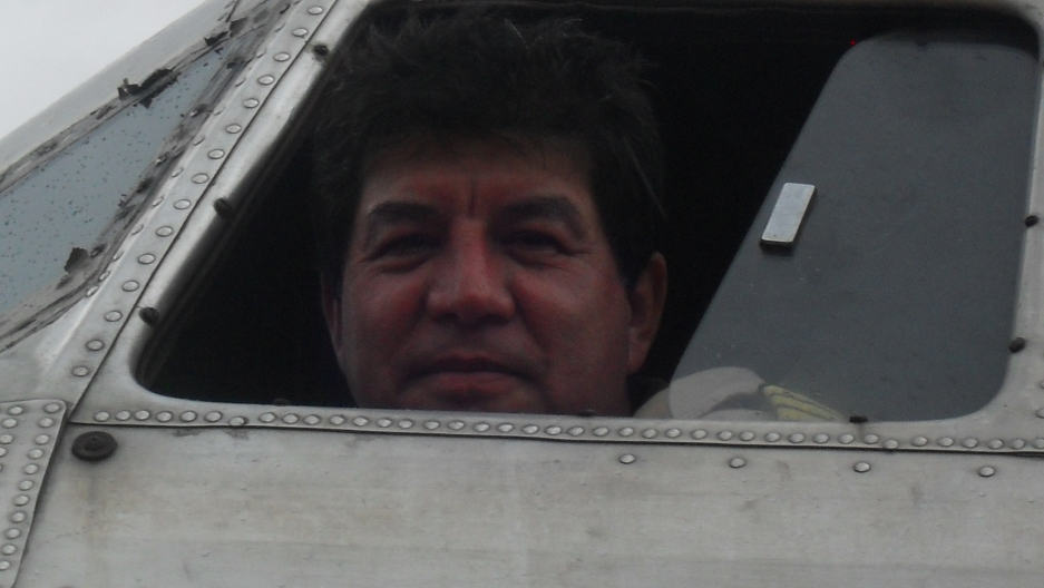 Pilot John Acero looks out the window of a DC-3.