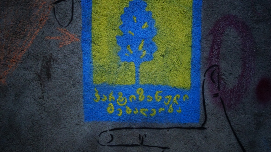 "This graffiti stencil proclaims ""Guerrilla Gardening"" a loose-knit movement of artists, engineers and civic activists fighting to keep Tbilisi from ceding public space to private developers."