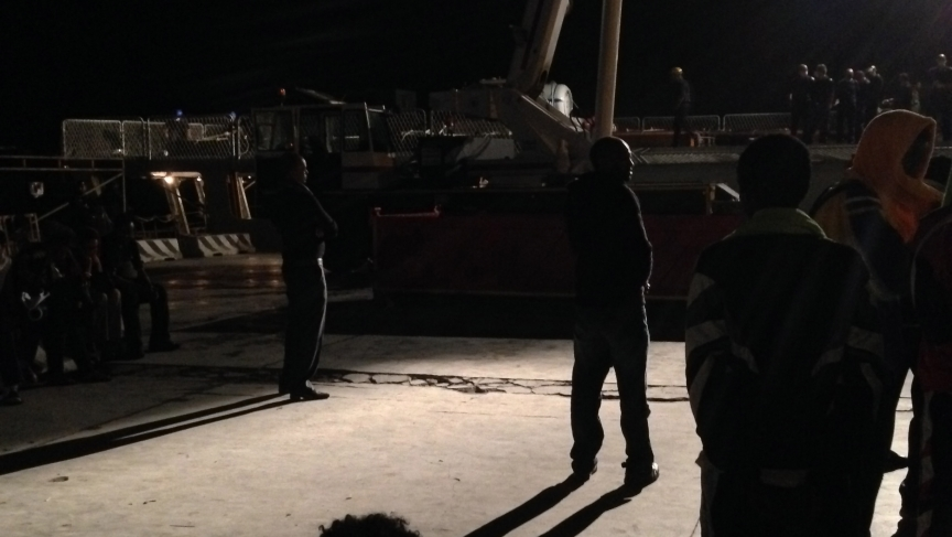 Families in the port watch coffins transport: Hundreds of people stood on Lampedusa's port on the night of October 13 to bid farewell to their loved ones as a crane transfers the coffins into a navy boat for an uncertain funeral in Sicily.