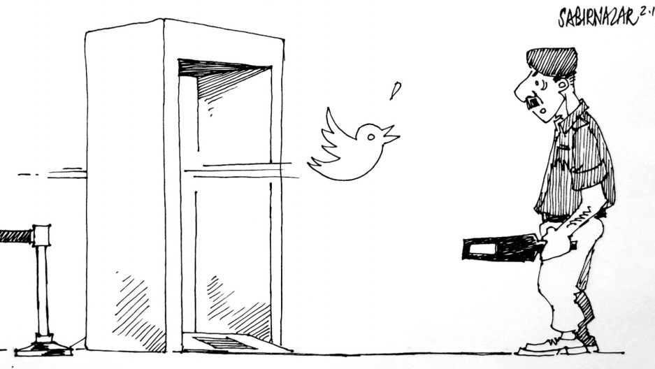 A Pakistani security official readies a medal detector to the check the Twitter bird after Twitter admits it has blocked certain tweets in Pakistan deemed 'blasphemous' by a Pakistani government official.