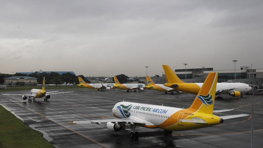 Cebu Pacific airways planes park at the tarmac at Ninoy Aquino International airport in Pasay city, metro Manila November 8, 2013, after nearly 200 local flights have been suspended due to Typhoon Haiyan that hit central Philippines on Friday.