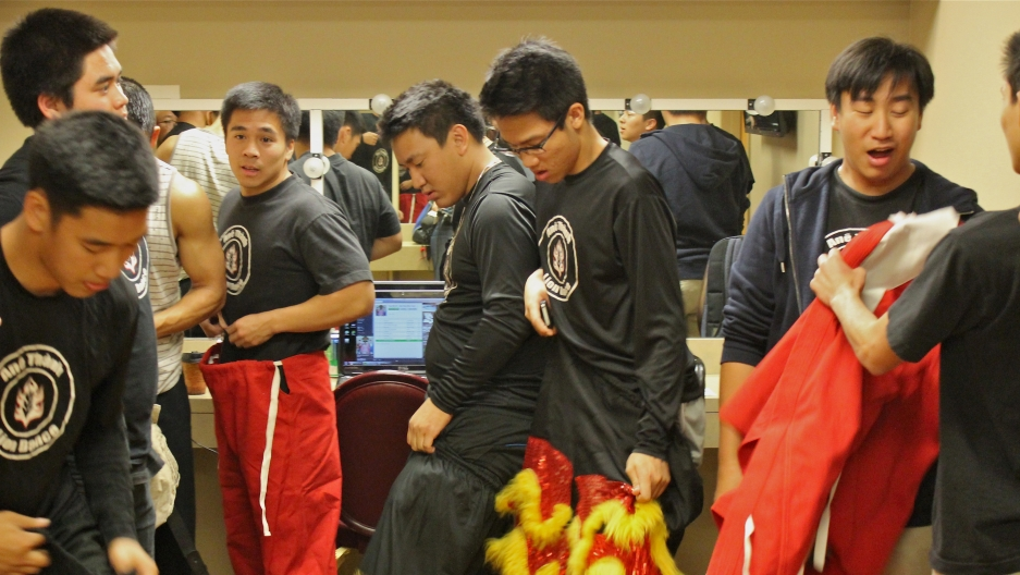 """Lion dancers get ready in their dressing room before they perform """"Paris by Night"""" in Southern California."""