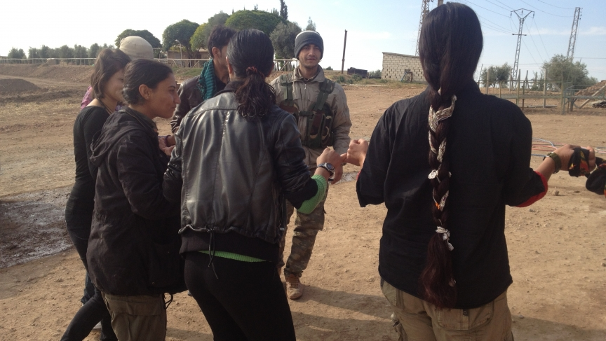 PYG fighters do traditional Kurdish dance