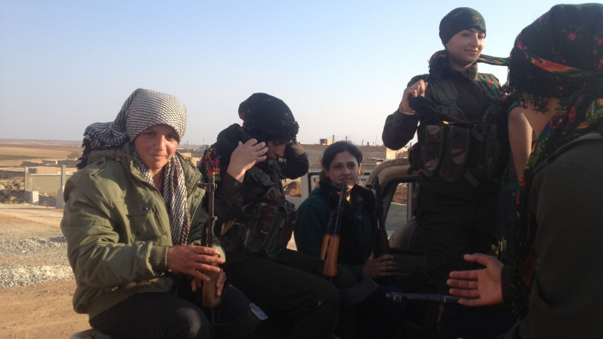 Female YPG fighters on pick-up truck