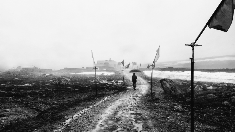 """An Indian soldier walks along Bum La Pass, in an """"no man's land"""" area, where both China and India have laid claim."""
