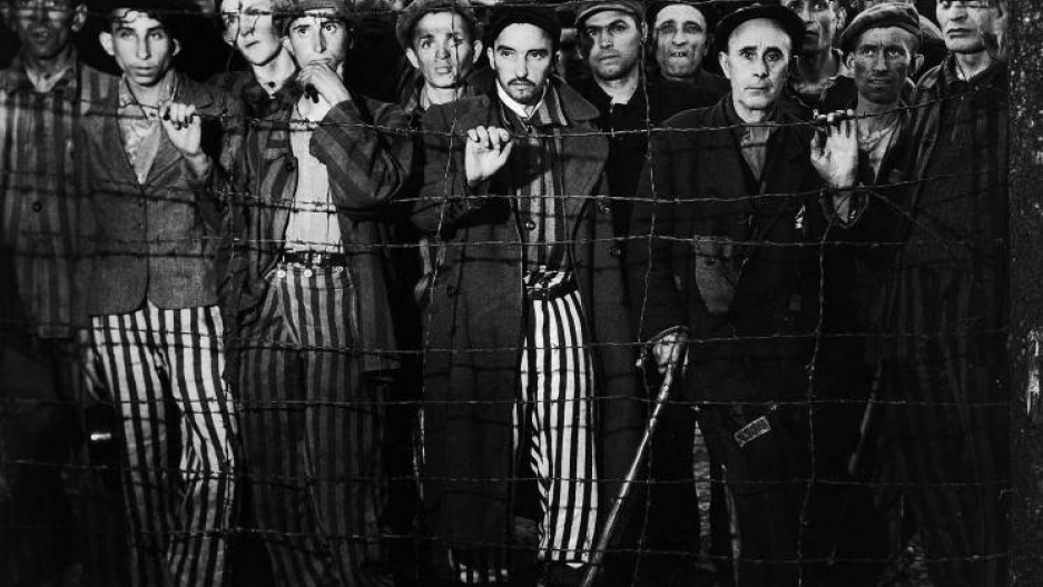 Survivors gaze at photographer Margaret Bourke-White and rescuers from the United States Third Army during the liberation of Buchenwald, April 1945.