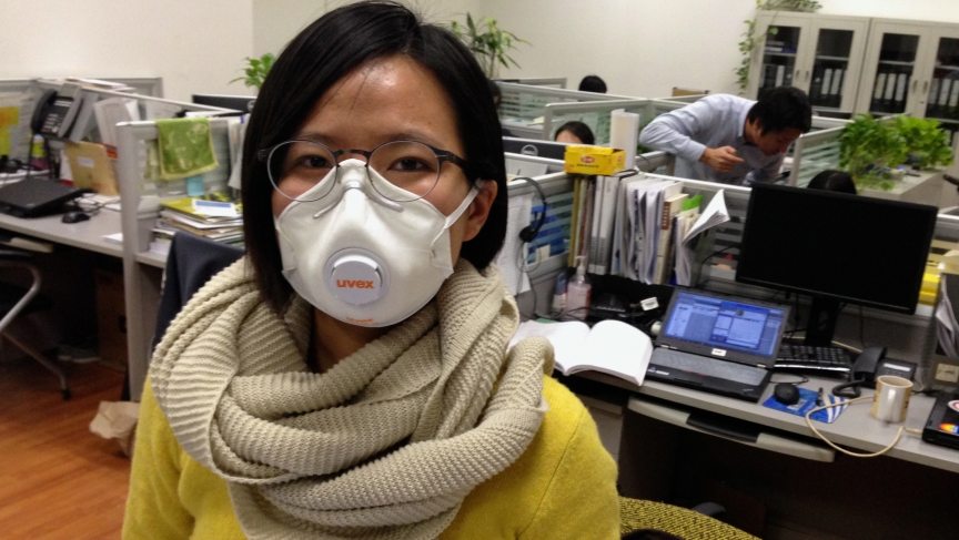 Huang Wei is an air quality expert with Greenpeace in Beijing. She ends up wearing a mask on her bike rides to and from work pretty often these days.