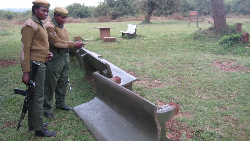 """Ranger Mildred Oduor (left) and Corporal Patricia Mututu inspect damage to a Nairobi National Park picnic area caused by a Cape buffalo.  """"Some may say [being a ranger] is a good job,"""" says Oduor, """"but others may not like it because it has a lot of risk."""""""