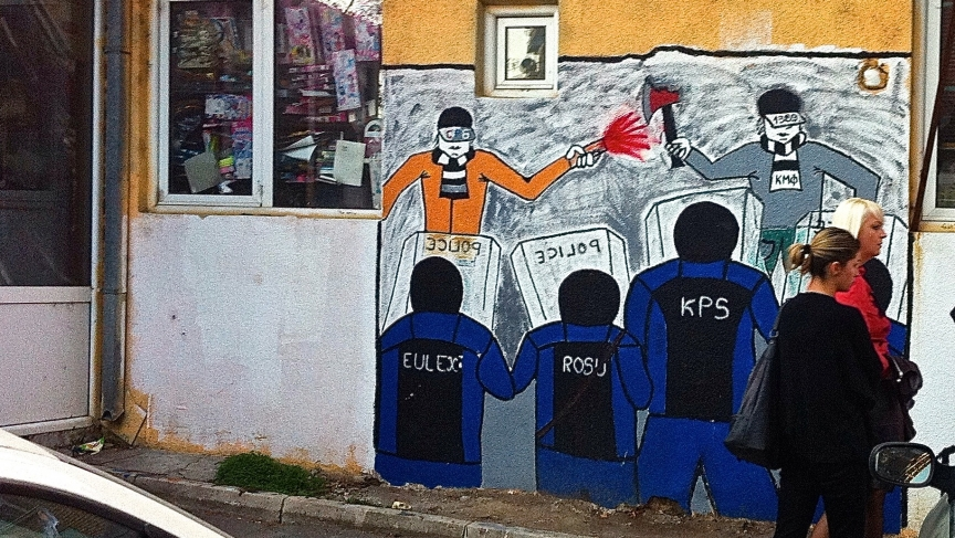 Demonstrators face off with Kosovo and EU police in this mural.