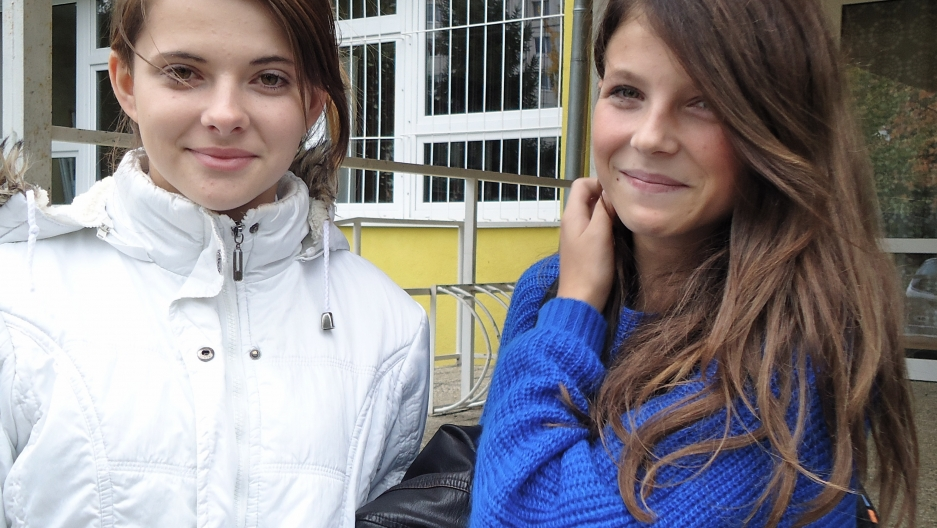 Two ninth-grade non-Roma students leave Šarišské Michaľany for the day.