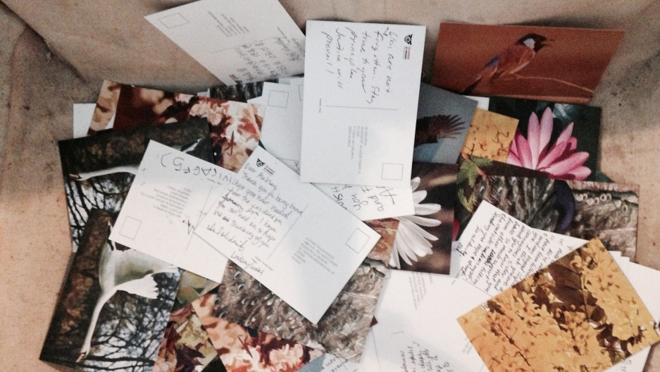 Visitors to the exhibit can fill out pre-addressed postcards to political prisoners around the the world and drop them in old Alcratraz laundry baskets.