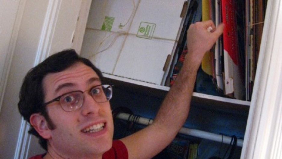 Scott Wiener packs hundreds of pizza boxes from around the world into his Brooklyn apartment.
