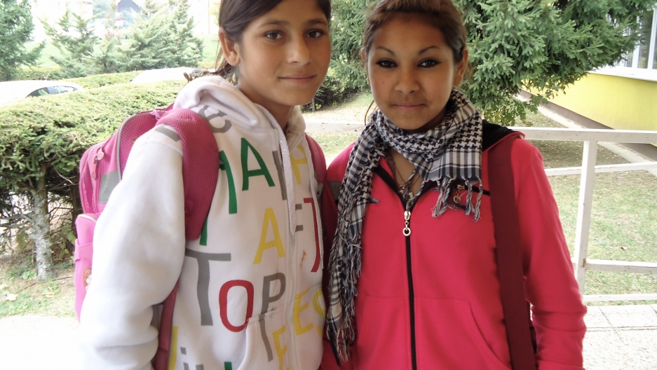 Two eighth-grade Roma students leave Šarišské Michaľany school for the day.