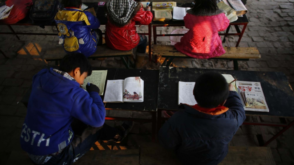 Students work at their lessons at the Democracy School in rural Henan province. The school, dedicated to Mao Zedong's teachings, struggles with limited funds. There's no heating and no indoor plumbing.