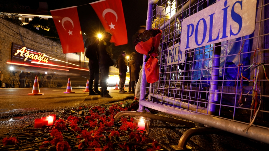 Police have erected barricades and mourners have left flowers outside Reina, the nightclub in Istabul where 39 died during a terrorist attack.