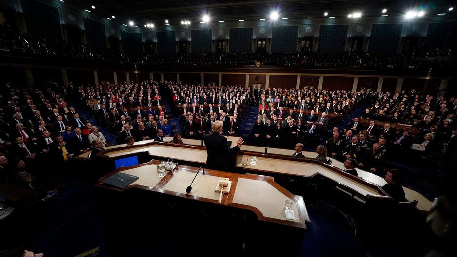 This is a view of the State of the Union crowd with Donald Trump at the center and the seated guests and Congress around him.