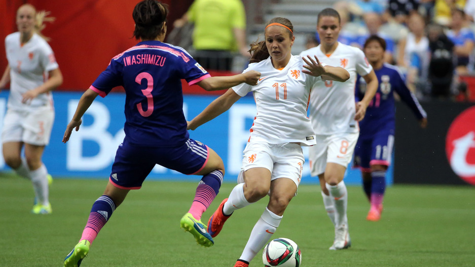 Netherlands forward Lieke Martens (11) controls the ball against Japan defender Azusa Iwashimizu (3) during the second half in the round of sixteen in the FIFA 2015 women's World Cup soccer tournament at BC Place Stadium.