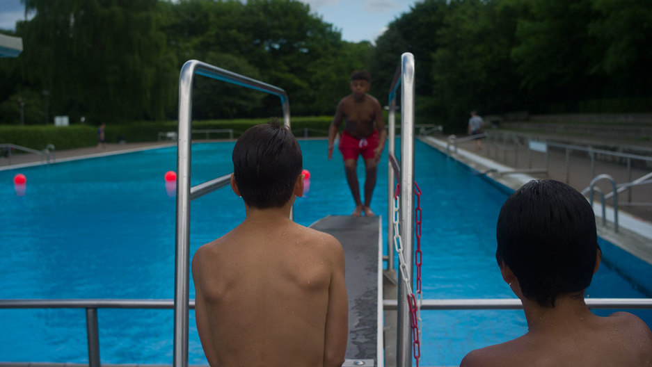 A young swimmer gets ready to leap off of a diving board at Sommerbad Neukolln, a public pool facility in Berlin. It's located in one of Germany's most ethnically diverse neighborhoods.