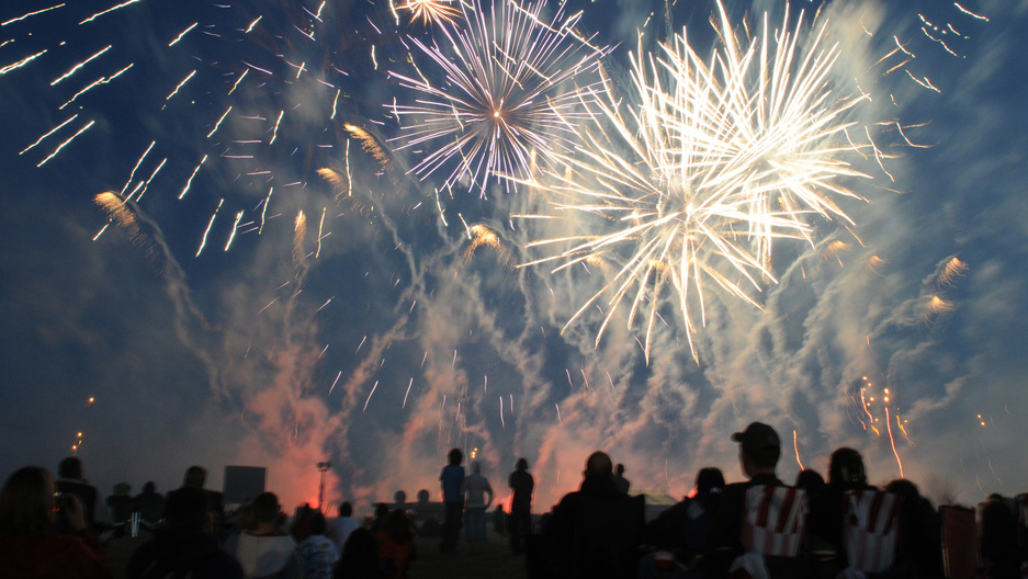 Fireworks light up the evening sky above RAF Feltwell during the annual 4th of July celebration. The festivities included games, rides, contests and food booths.