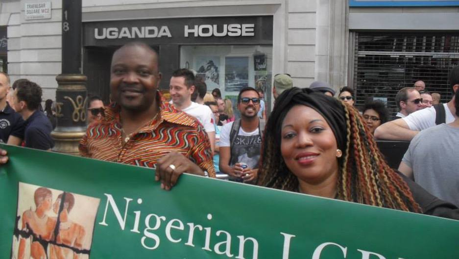 Nigerian gay rights activist Davis Mac-Iyalla (left) holding a banner at London's 2013 Pride Parade protesting anti gay rights laws. On January 7th, Nigerian President Goodluck Jonathan signed the Same Sex Marriage Prohibition Act, which criminalizes gay