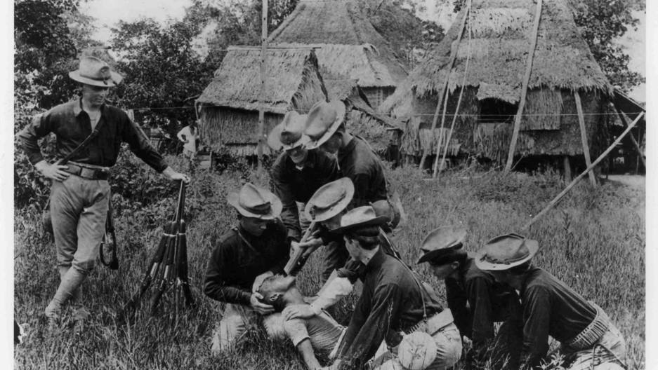Soldiers from the 35th US Volunteer Infantry subject a Filipino to the 'water cure,' a common 'enhanced interrogation' technique employed during the war to pacify the Philippines between 1899 and 1902.