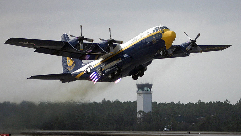 "The US Marine Corps C-130 Hercules named ""Fat Albert,"" assigned to the US Navy ""Blue Angels"" flight demonstration team, uses Jet Assisted Take Off bottles during the 2005 Blue Angel Homecoming show."