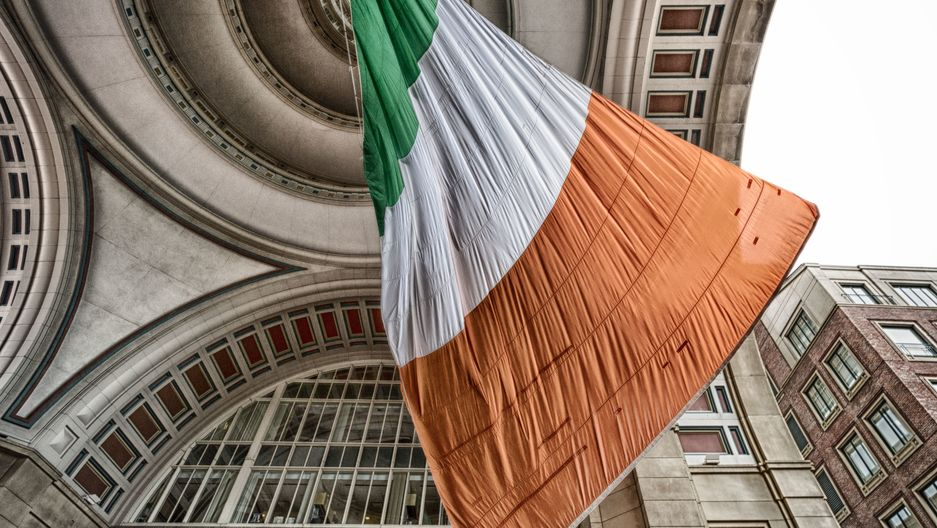 large flag of Ireland hanging in building rafters