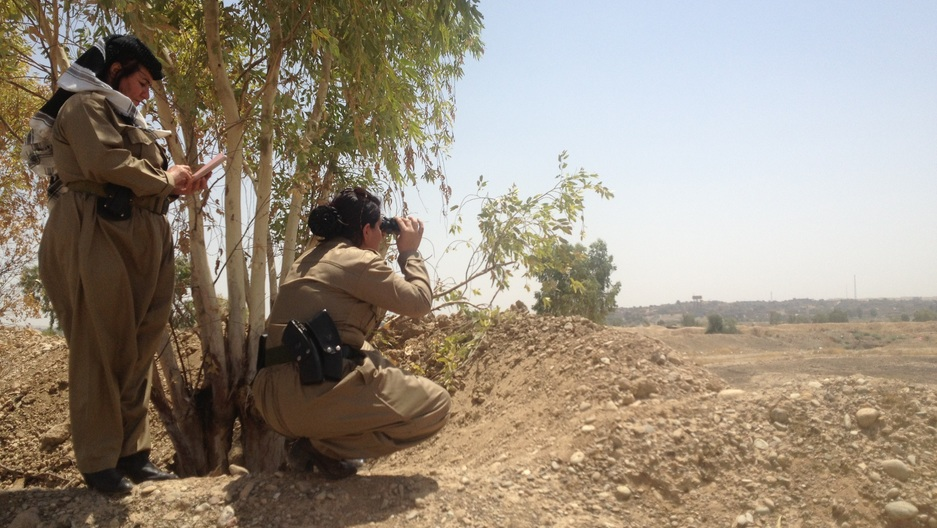 Female fighters from Colonel Nahida's peshmerga battalion view the front lines with ISIS.