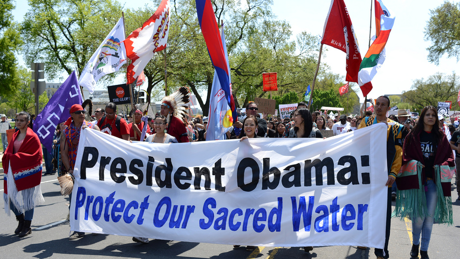 Native Americans march during an anti-Keystone XL protest in Washington on April 26, 2014.