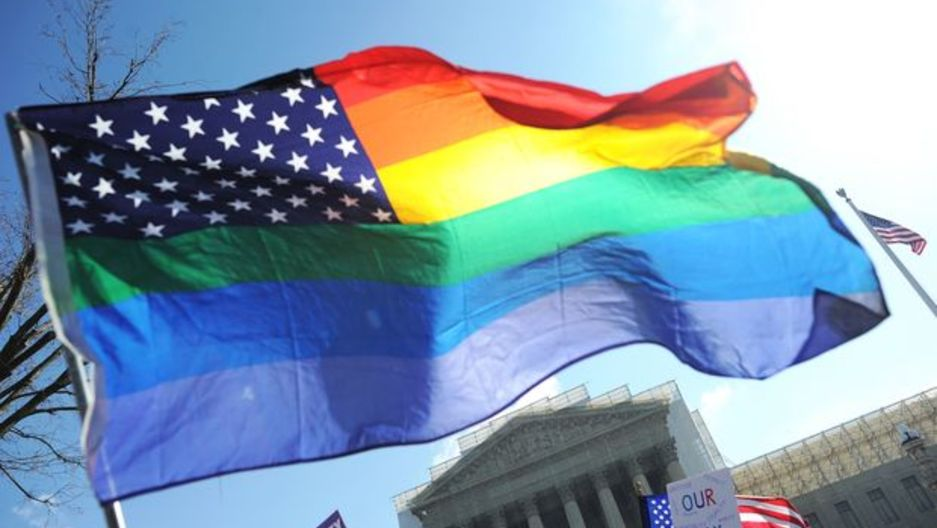 Same-sex marriage supporters wave a rainbow flag in front of the US Supreme Court on March 26, 2013 in Washington, DC