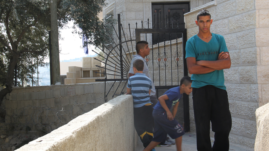 Palestinian residents in front of the Baydoun home recently occupied by Israelis.