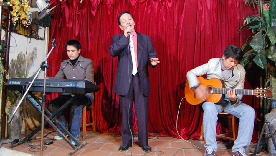 "Nguyễn Văn Lộc takes the stage several nights a week at his cafe, performing many of Vietnam's most popular love songs, in a style called ""nhạc trữ tình,"" which means ""romantic music."""