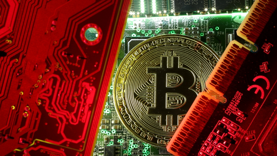 A bitcoin on a computer motherboard
